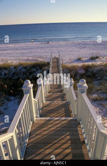 Stairway leading down to white sand beach Florida Seaside - Stock Image