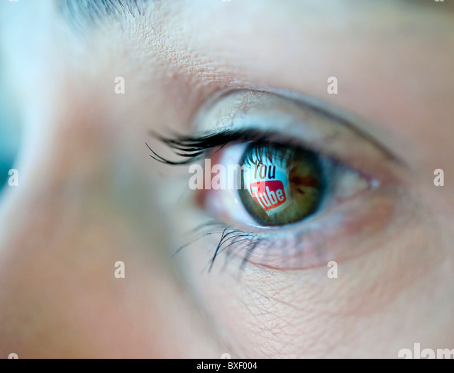Logo from Youtube video sharing website reflected in an eye - Stock Image