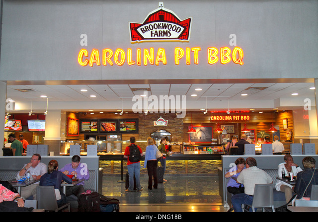 Charlotte North Carolina Charlotte Douglas International Airport CLT terminal concourse gate area restaurant Brookswood - Stock Image