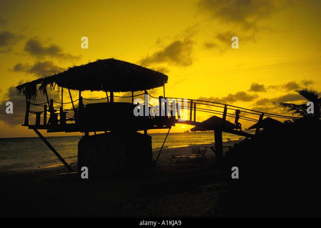 Aruba Beach Bar Sunset Silhouette - Stock Image