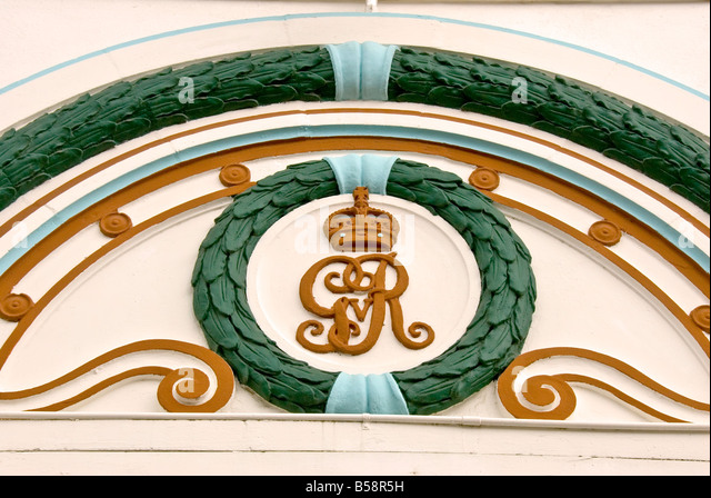 Belize City ornate door decoration gold crown surrounded by green wreath Central Amieica cruise destination - Stock Image