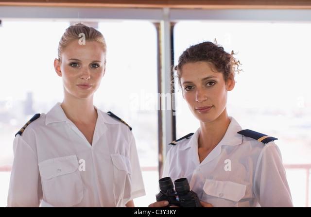 Female sailors with telescope - Stock Image