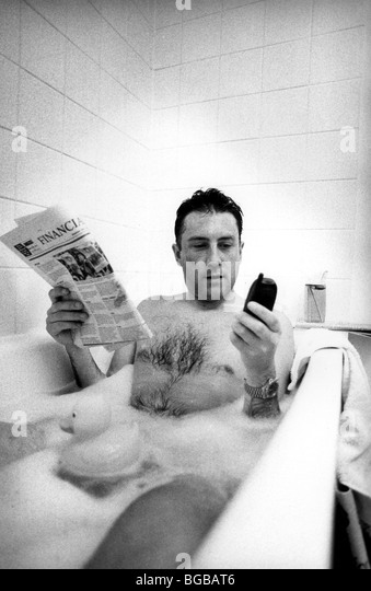 Photograph of business man bath checking hare prices investments - Stock-Bilder