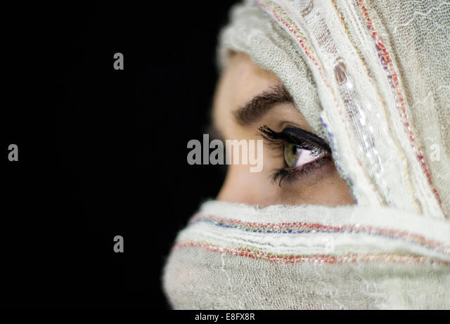 View of girl with face covered - Stock Image