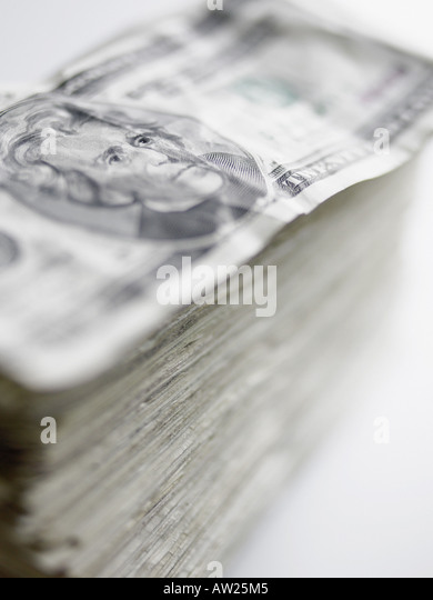Pile of twenty dollar notes - Stock Image