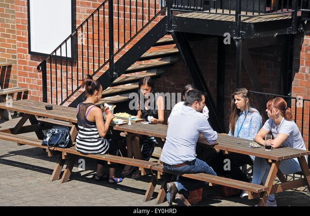 People dining outside pub stock photos people dining for Table 8 beeston