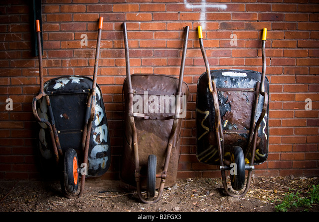 Wheelbarrows stock photos wheelbarrows stock images alamy for Allotment tools for sale