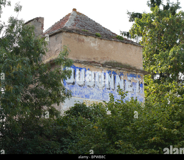 French Advertising Mural on Wall of Old House in Burgundy, France. - Stock Image
