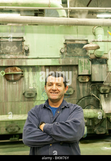 Man standing in machine hall - Stock Image