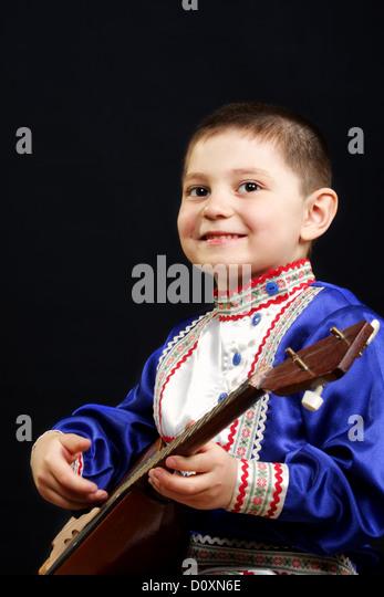 Smiling boy with balalaika - Stock Image