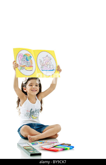 Girl showing her drawings - Stock-Bilder
