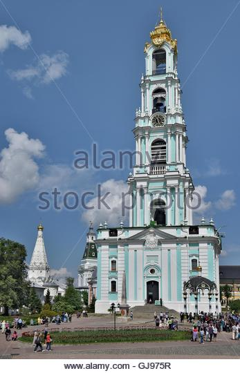 Many of pilgrims and tourists in the main square at the Cathedral of the Holy Trinity St. Sergius Lavra in Sergiyev - Stock Image