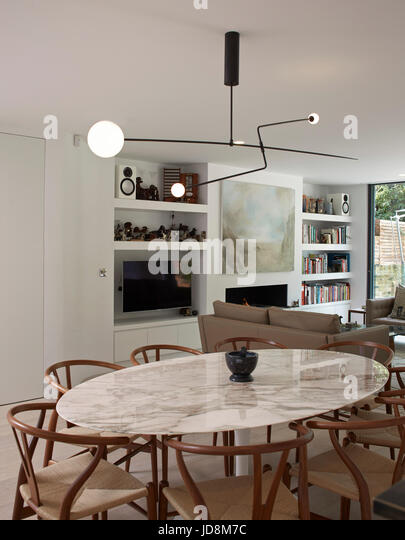 Ground floor over dining table with Michael Anastassiades Mobile Chandelier. Notting Hill House, London, United - Stock-Bilder