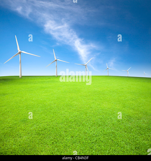 Wind turbines in an green field with cloud background - Stock-Bilder