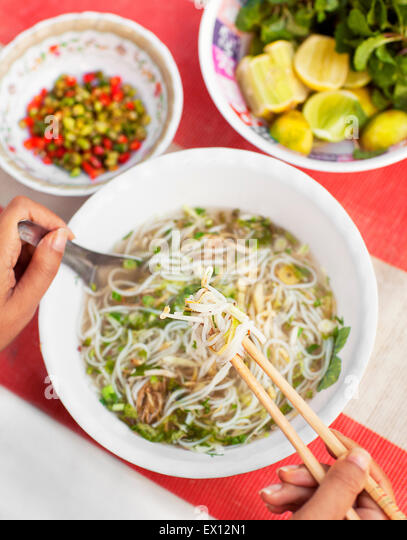 Noodle stand at morning market; bowl of noodle soup. Luang Prabang, Laos. - Stock-Bilder