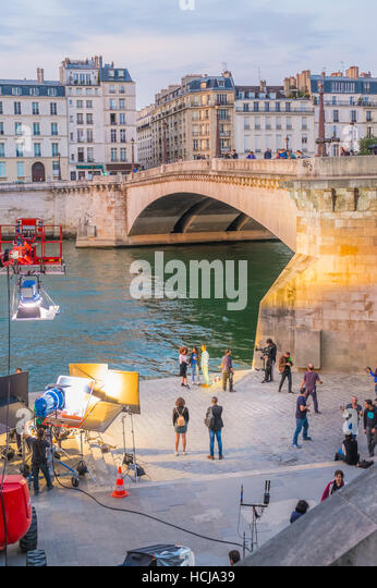 film shooting operations at dusk on the banks of river seine - Stock Image