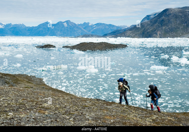 Ice blocks and mountains, Sermilik Fjord, East Greenland - Stock Image