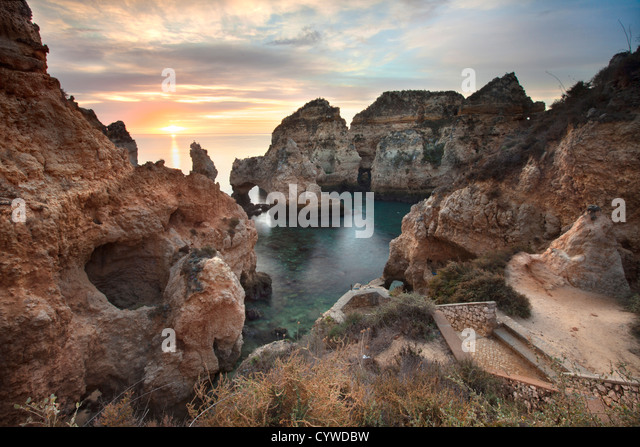 Ponta da Piedade sea stacks and arches captured at sunrise, Portugal. - Stock-Bilder