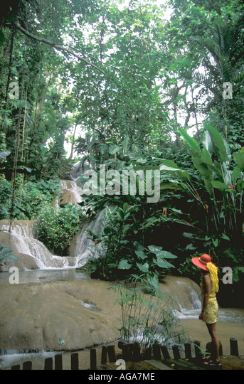 Jamaica woman at Enchanted Gardens waterfall Ocho Rios - Stock Image