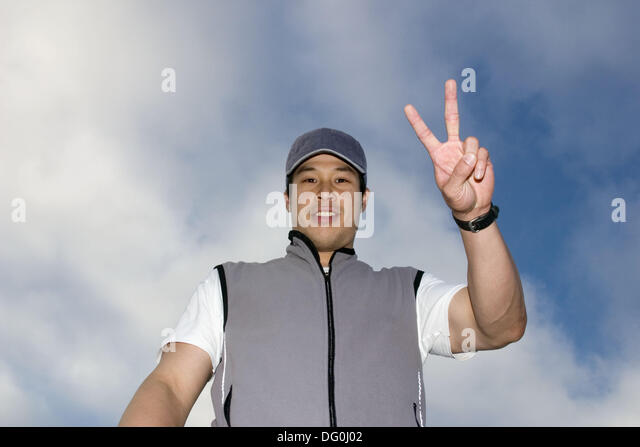 Portrait of an athletic young Asian man. - Stock Image