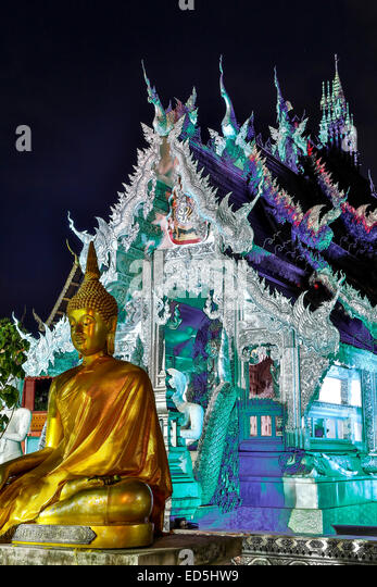 Statue of Buddha and Wat Sri Suphan (Silver Temple), Chiang Mai, Thailand - Stock Image