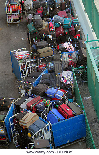 New Orleans Louisiana Port of New Orleans cruise ship luggage baggage bag bins carts cargo loading unloading checked - Stock Image