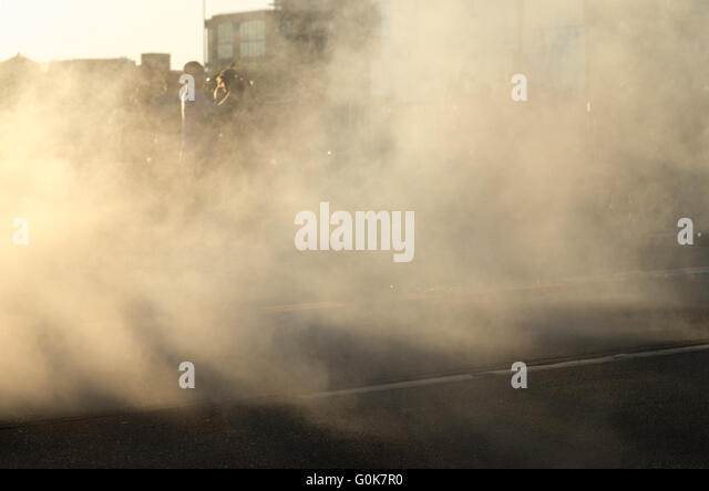 Seattle, USA. 1st May, 2016. The street is filled with smoke after law enforcement responded with crowd dispersal - Stock Image