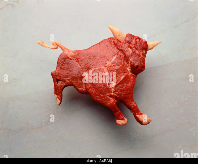 Raw meat shaped liked a bull - Stock-Bilder
