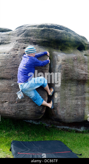 rock climber bouldering at Burbage Edge South, Derbyshire, Peak District National Park, England, UK, United, Kingdom - Stock Image