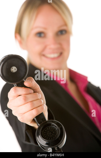 Businesswoman Holding Telephone Receiver - Stock-Bilder