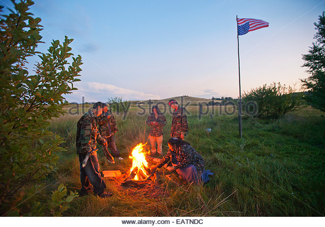 Oglala youths hang an upside-down flag as an act of defiance toward the U.S. government. - Stock Image