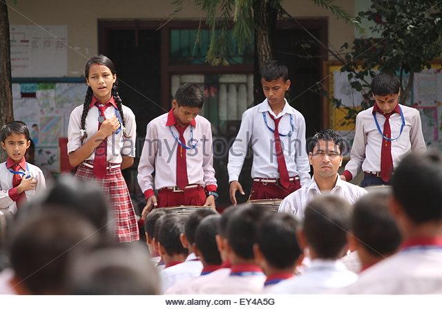 Bhaktapur, Nepal. July 20th, 2015. NEPAL, Bhaktapur:  Young children say morning prayer at Candid International - Stock Image