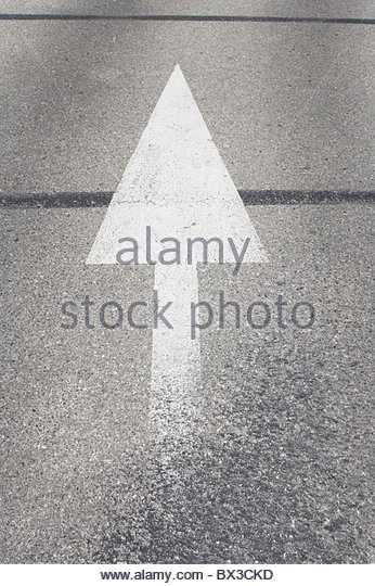 arrow sign on road - Stock Image