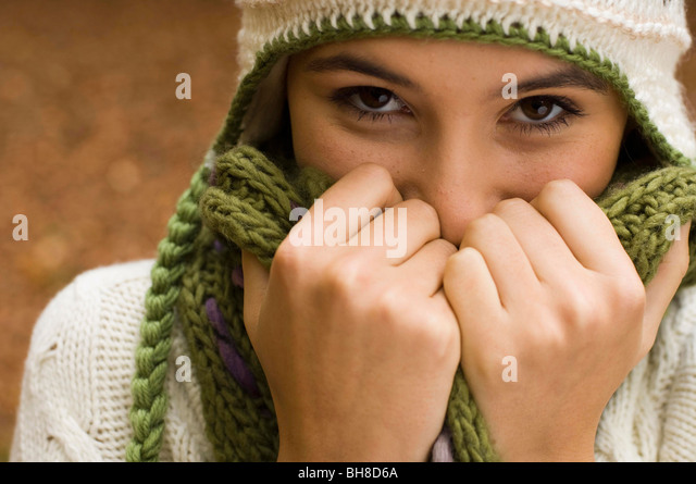 close up hands and face - Stock Image