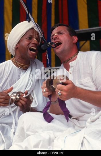 New York, NY - Men chanting with cymbals during the Hare Krishna Festival of the Chariots in Washington Square Park - Stock Image