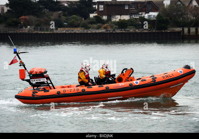 RNLI inshore rescue lifeboat heads back to Shoreham Lifeboat Station - Stock Image