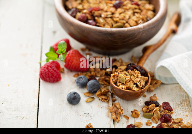 Homemade granola with milk for breakfast - Stock Image