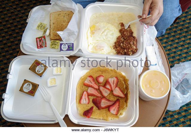 Miami Florida food take-out styrofoam container eggs pancakes breakfast - Stock Image