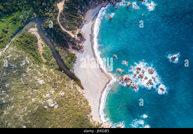 Aerial view of the amazing turquoise beach.  Emerald Coast in Sardinia Island, is one of the most beautiful and - Stock Image