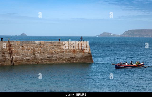Cornish gig boat in Sennen Cove harbour Cornwall UK - Stock Image