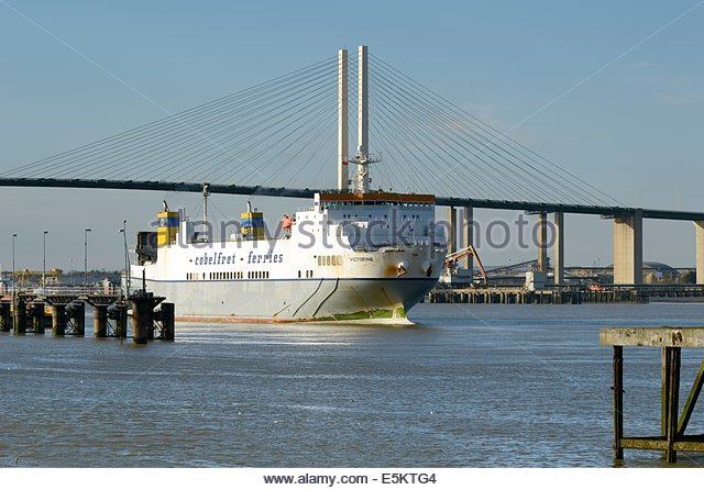 RO-RO cargo ship VICTORINE passing under the QE2 bridge on the river Thames, Cobelfret Ferries, Greenhithe, Kent, - Stock Image