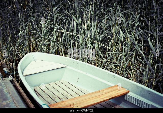 boat,rowboat,shore - Stock Image