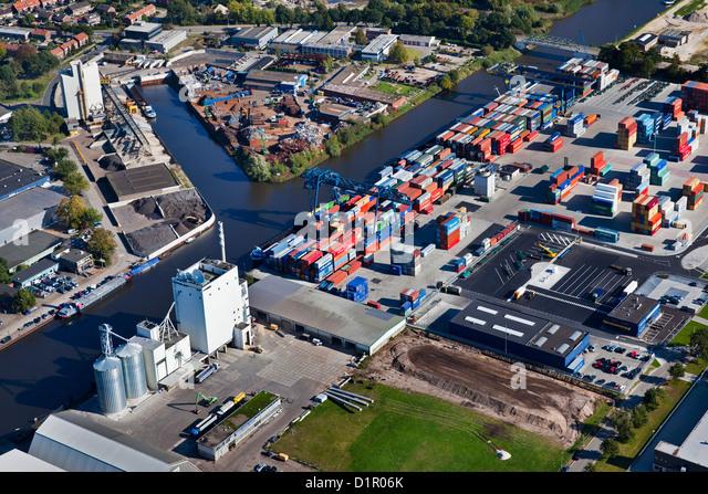 The Netherlands, Hengelo, Combi Terminal Twente, container transhipment. Canal called Twentekanaal. Aerial. - Stock Image