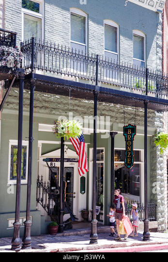 Arkansas Eureka Springs Spring Street historic building renovated shopping woman children wrought iron balcony specialty - Stock Image