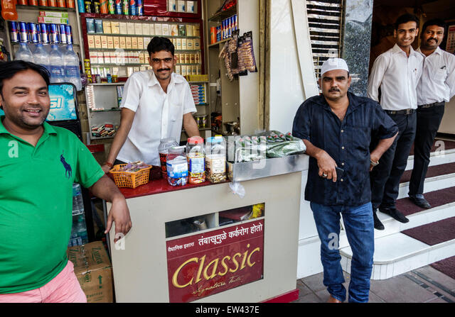 India Indian Asian Mumbai Tardeo Jehangir Boman Behram Road man friends street convenience store stall sidewalk - Stock Image