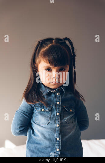 Portrait of beautiful sad girl at home. - Stock Image
