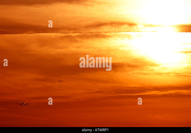 Airplanes coming to land - Stock Image