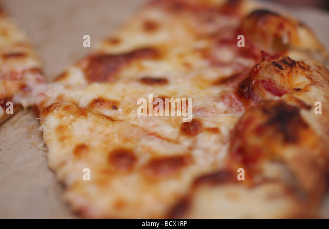 Close up of pizza slices in a take out box - Stock Image