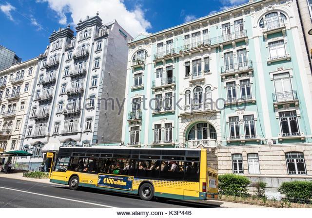 Lisbon Portugal Rua Braamcamp Hotel Expo Astoria building exterior bus public transportation stop city skyline - Stock Image