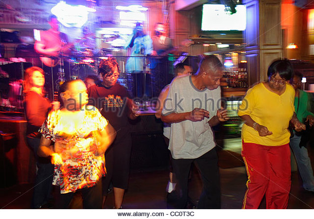 New Orleans Louisiana French Quarter Bourbon Street bar club live music entertainment nightlife nightclub musician - Stock Image